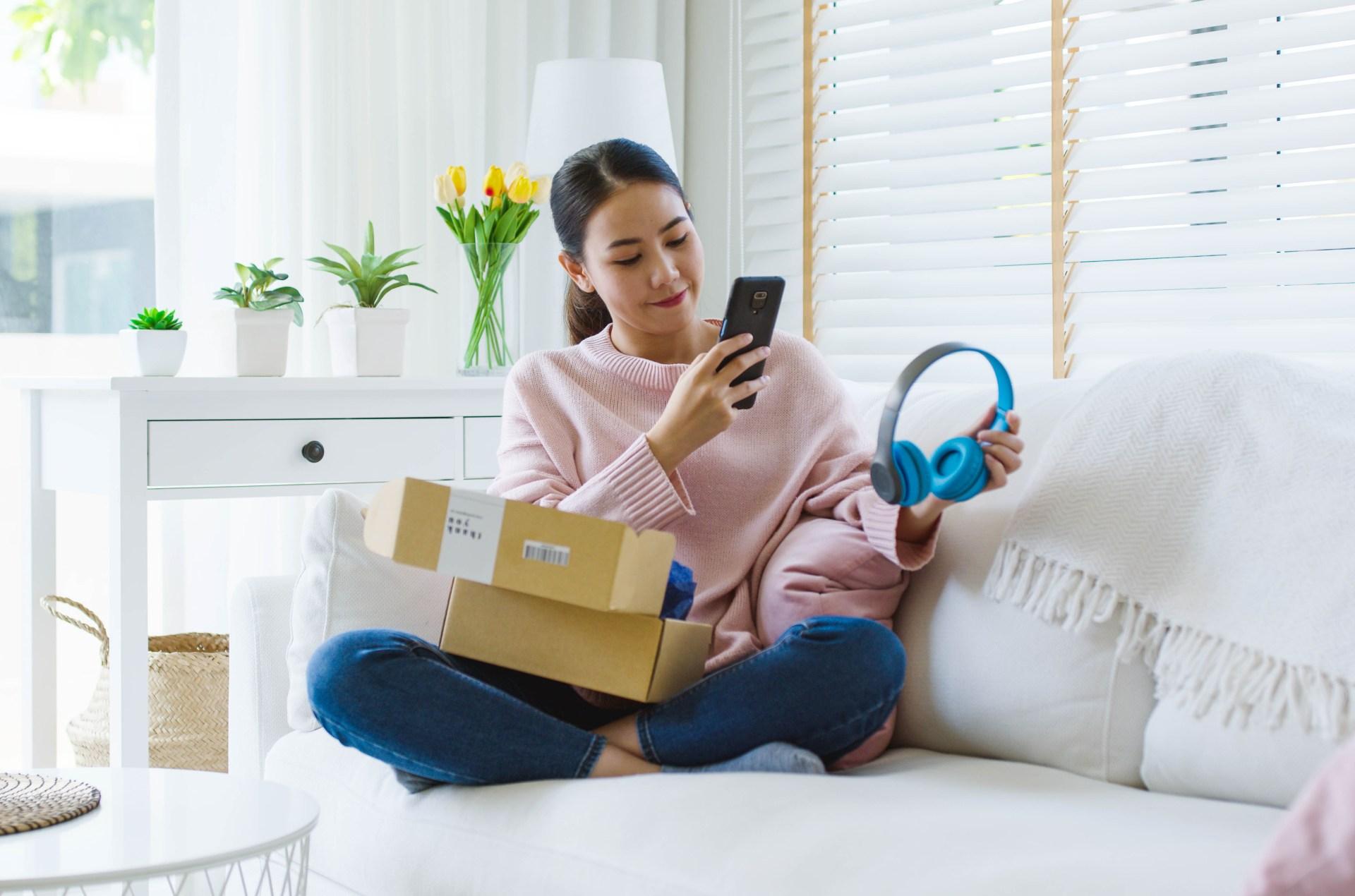 Teen girl opening package