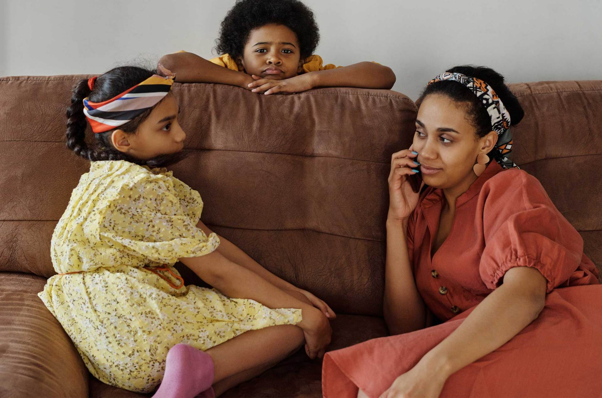 Children with their mother on a sofa