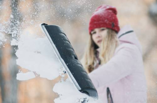 Girl shovelling snow as a chore for allowance