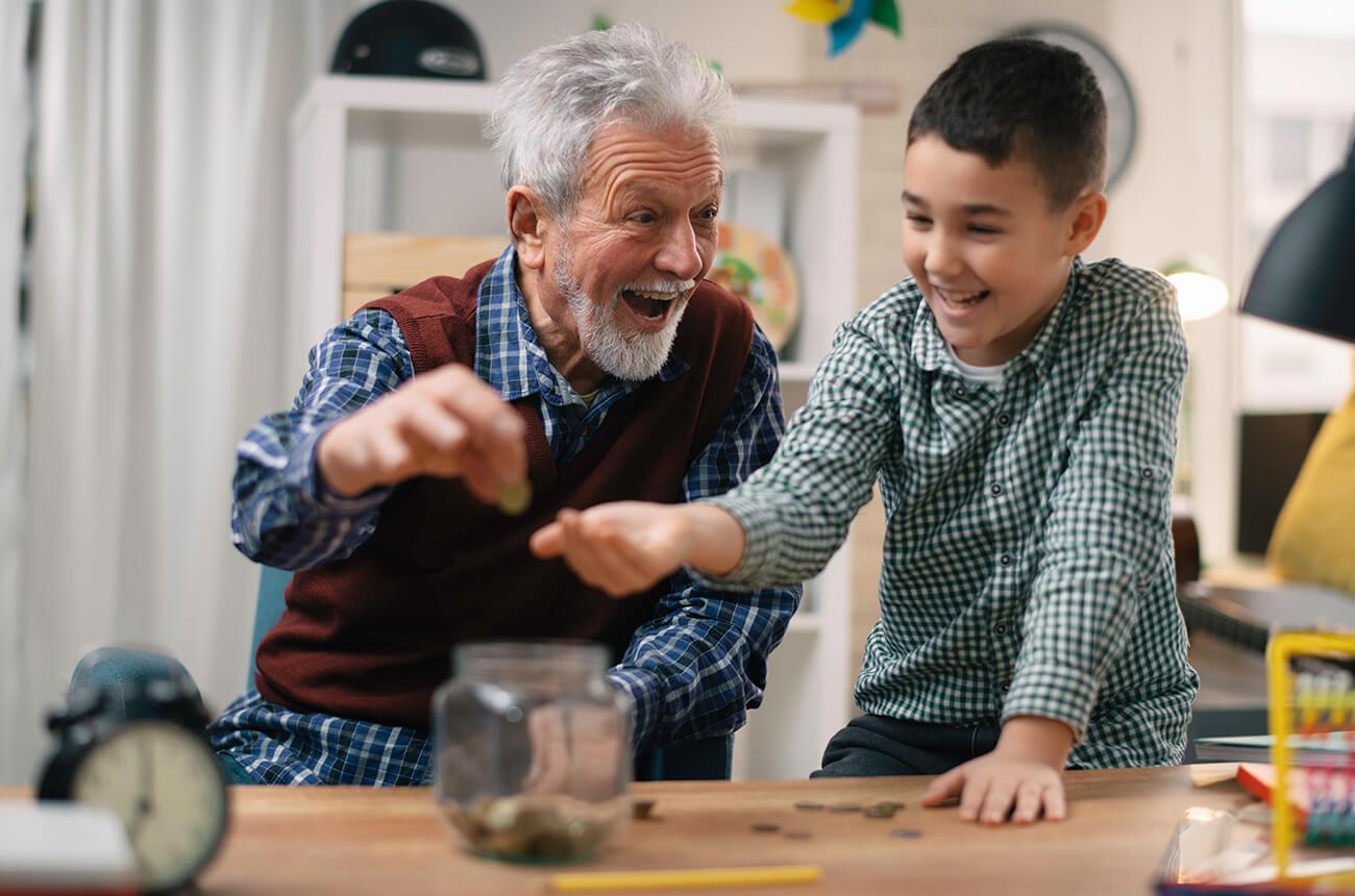 A grandpa giving his grandson an allowance