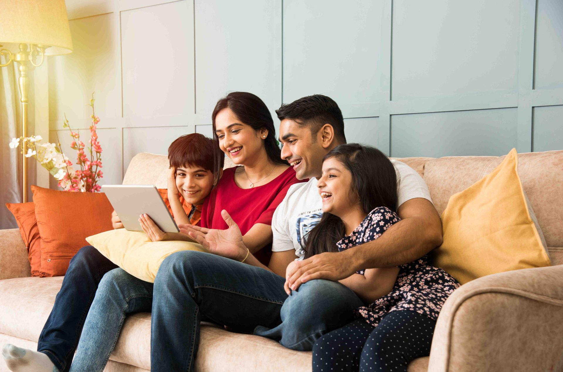 Family sitting together on couch learning about money