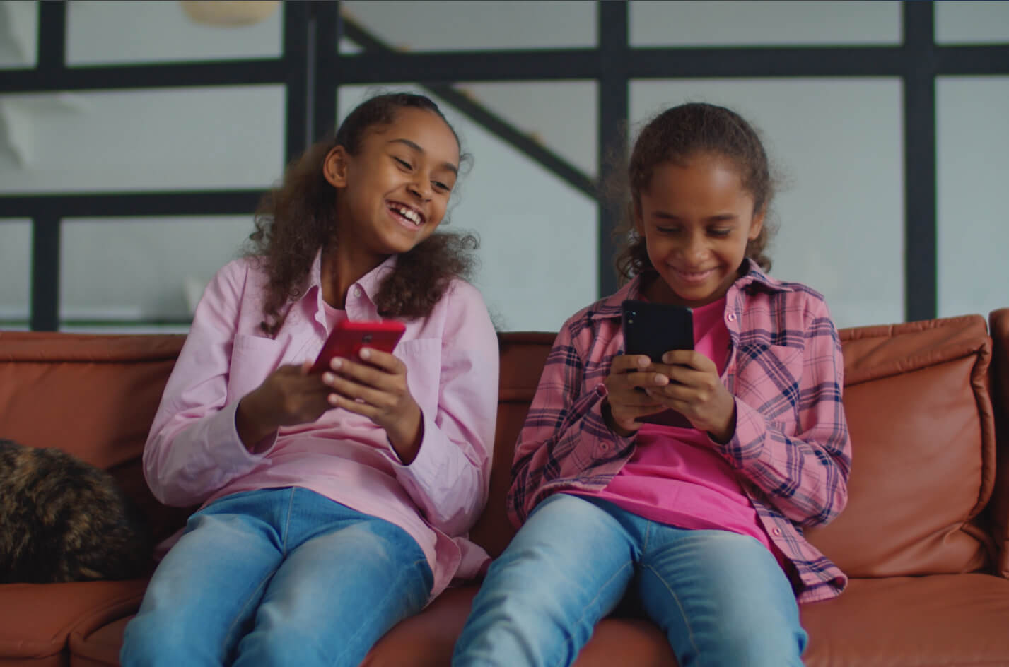 Two kids using the Mydoh money app together
