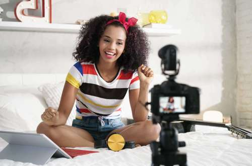 A girl recording a video and using a tablet