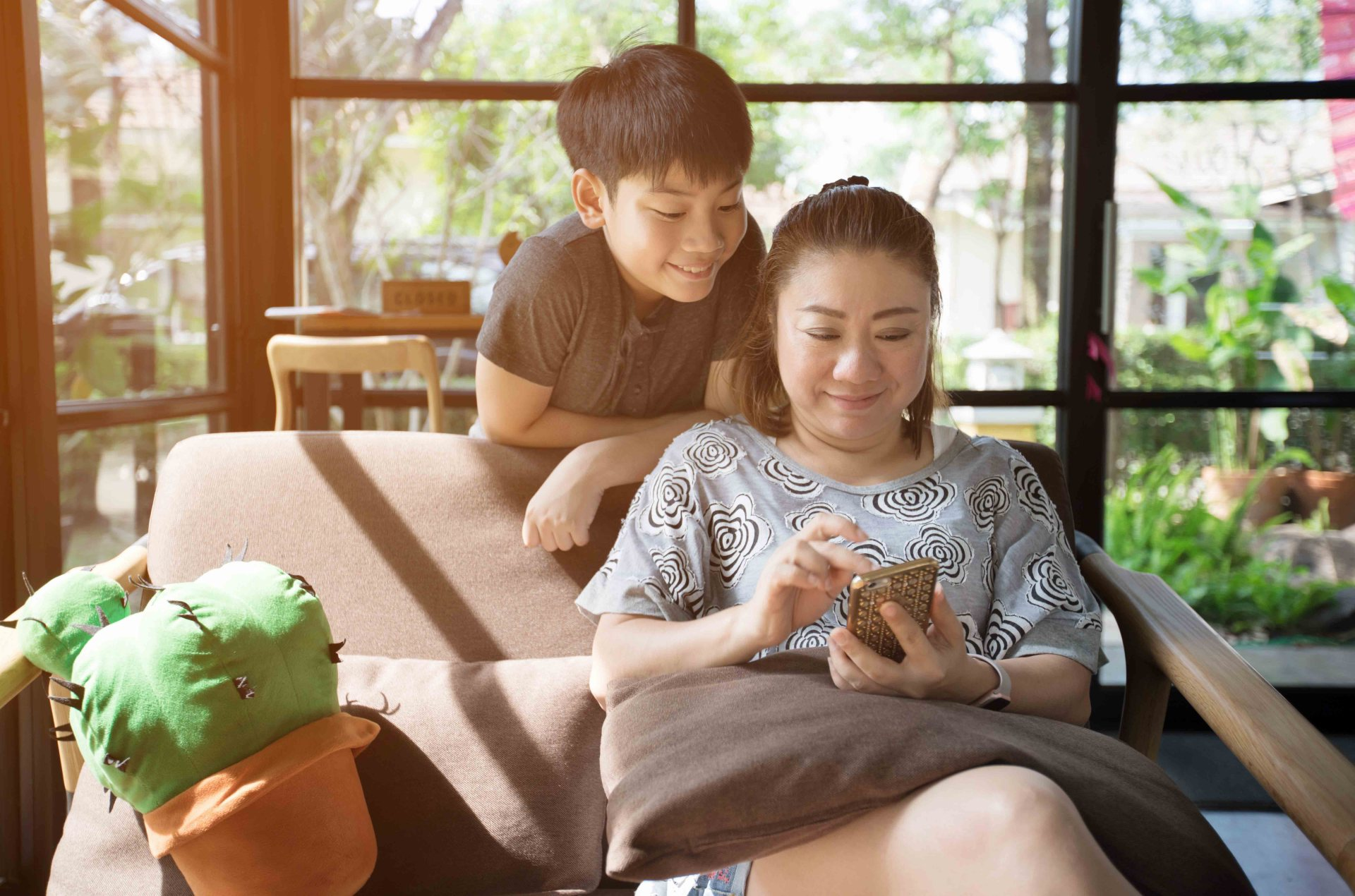 Mom and her son setting up an account on the Mydoh money management app for kids