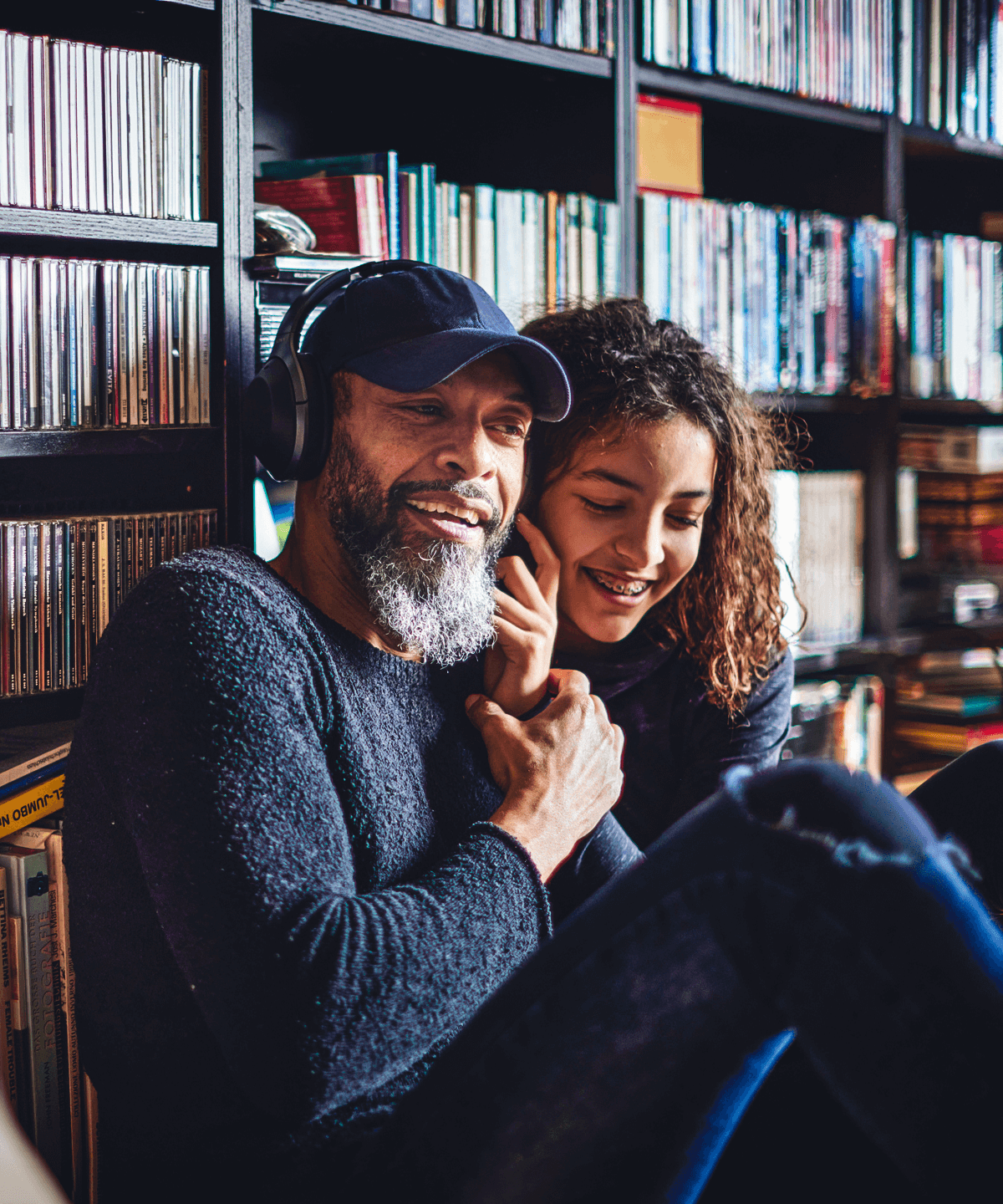 A father and his daughter listening to music together
