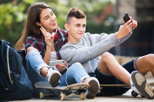 Teenagers taking a selfie on Snapchat