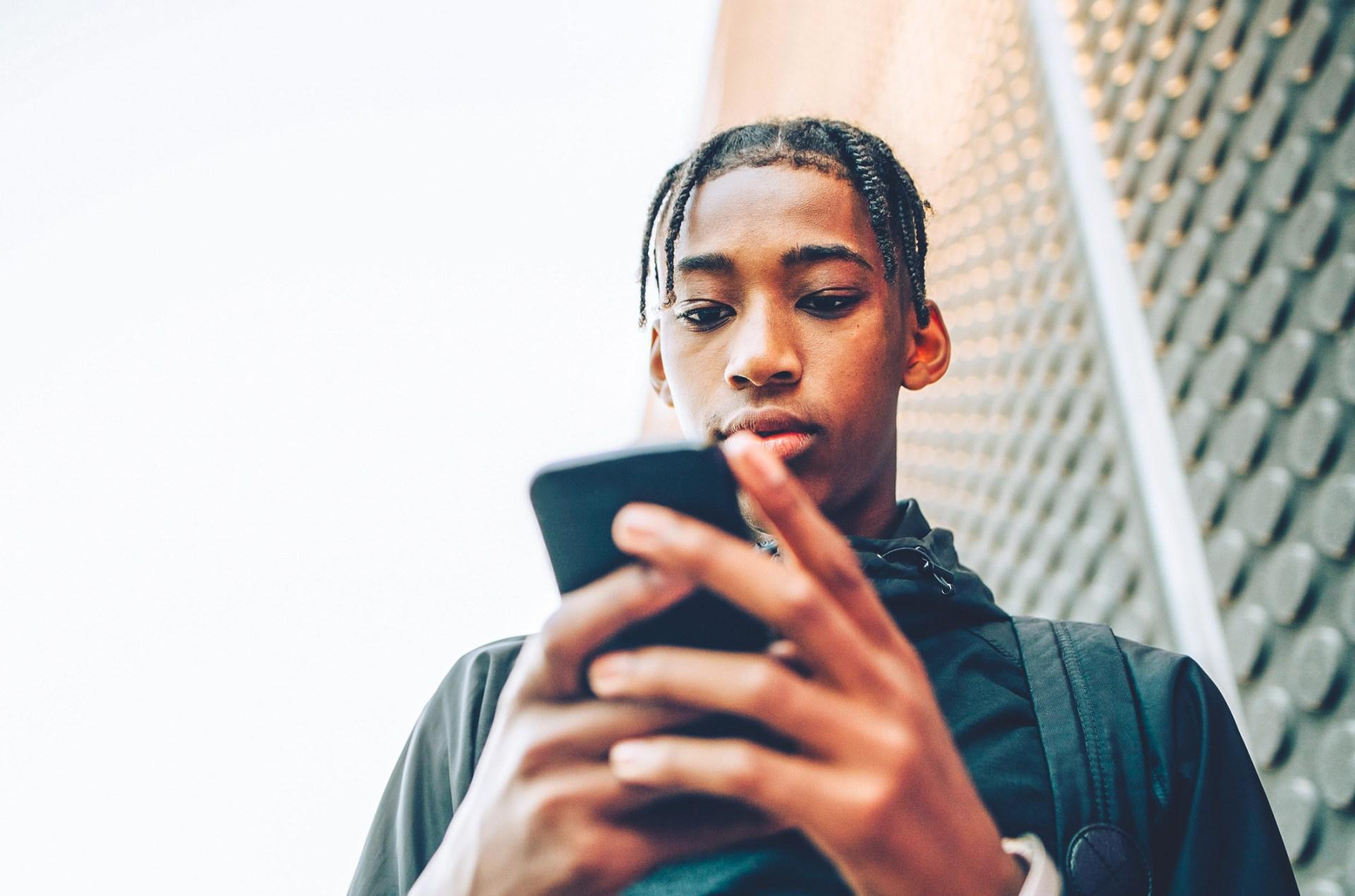 teen on their phone
