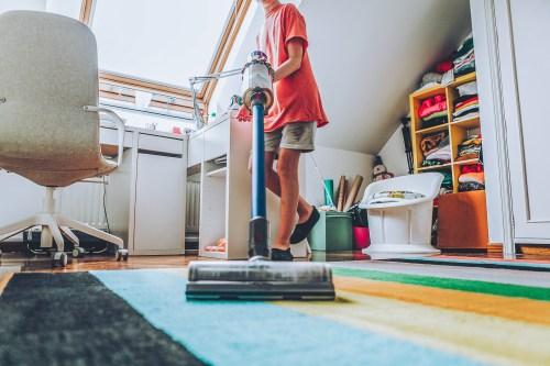 teen vacuuming house